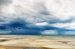 Stormy sky and beach at low tide Royalty Free Stock Photo