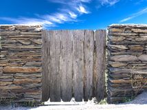 Nature summer landscape. Countryside view and rustic gate in drystone wall in village Cadaces royalty free stock photography