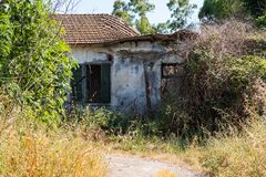 Nature surrounding a decayed abandoned house stock photos