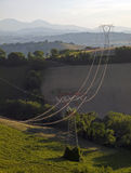 Nature and Technology. High voltage pylons at countryside Stock Photos