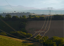 Nature and Technology. High voltage pylons at countryside Stock Images