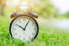 Nature times clock outdoor green nature. Background royalty free stock photos