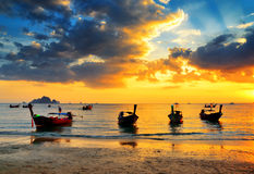Traditional thai boats at sunset beach.  Royalty Free Stock Images