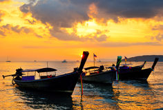 Traditional thai boats at sunset beach Royalty Free Stock Images