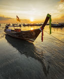 Traditional thai boats at sunset beach Stock Photography