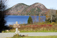 Nature Trail at Jordan Pond. View of Cadillac mountain across Jordan Pond in Acadia National Park in the fall Stock Photo