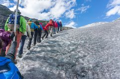 Glacier guided tour in Norway. Nature travel in Norway - group of tourists in glacier tour Stock Photos
