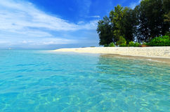 Tropical beach. Blue sky and clear water Royalty Free Stock Photography
