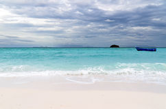 Tropical beach at cloudy weather Royalty Free Stock Photo