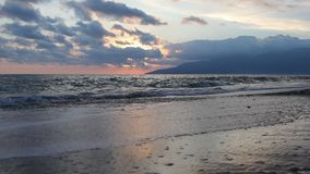 Nature in twilight period which including of sunrise over the sea and the nice beach. Summer beach with blue water and purple sky at the sunset stock footage