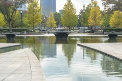 Nature or urban background with view of park in Tokyo, Japan. With trees and tall buildings of Marunouchi district illustrating modern urban ecology concept royalty free stock photography