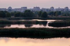Nature versus city, wild lake close to neighborhood. In Bucharest, Romania Stock Photos