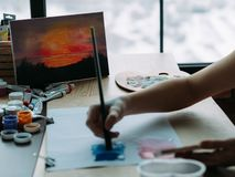 Nature view painting talented artist landscape. Nature view painting. Cropped shot of talented female artist creating landscape artwork in studio stock photo