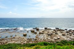 Taiwan Nature Seaside view. Nature view of stones and seaside in Taiwan with bright sunny clear blue sky royalty free stock photo