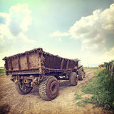 Nature-16. Vintage nature background cart with dung Royalty Free Stock Image