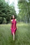 Nature Wanderer. A Young Woman is Wandering in the Woods with Cautious Admiration Stock Photo