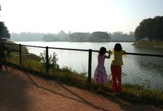 Nature Watchers. Two girls looking at landscape around Lal Bagh Lake, Bangalore, India, Asia Stock Photography