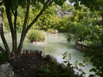 Nature, whater and relax in San Antonio,Texas,. A quiet corner of the riverwalk, full of plants and flowers, where you can enjoy peace and tranquility Stock Photos