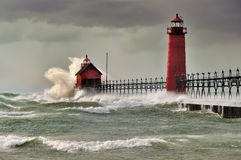 Natures Fury Grand Haven Lighthouse. Gale force winds pound the Grand Haven Lighthouse. Grand Haven , Michigan - Lake Michigan shoreline royalty free stock photos