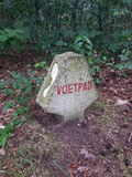 Natures Guide. Guide made  of stone telling to follow footpath Stock Image