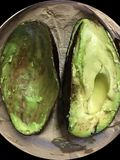 Awesome, glorious avocado being enjoyed. Natures wonder food, the avocado; the color green, the color of nature. The two are inseparable. No mater how you enjoy Stock Photography