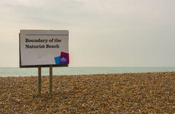 Naturist beach sign at Brighton, Sussex, England. Sign showing the boundary of the naturist beach at Brighton, East Sussex, England stock photo