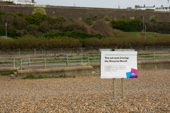 Naturist beach sign at Brighton, Sussex, England. Sign showing the boundary of the naturist beach at Brighton, East Sussex, England royalty free stock photo