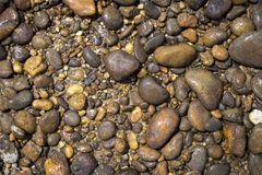 Naturkonzepthintergrund des Flusssteins Stockfoto