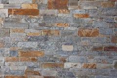 Naturlig bakgrund för modell för vägg för stengranittegelsten som är contemporar Royaltyfri Foto