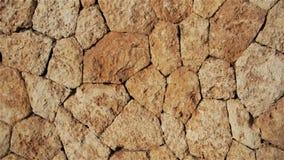 Naturlig brun bakgrund av stenar och kullersten lager videofilmer