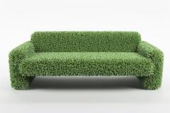 Naturlig designsoffa som göras från gräs på vit bakgrund Arkivfoton