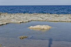 Naturlig pöl som grävas i vagga Fotografering för Bildbyråer