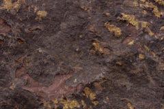 naturlig sten för bakgrund Röd rostig stentextur Royaltyfria Bilder