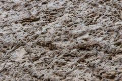 Naturlig sten, vulkaniskt ursprung, strukturellt, texturerat som är grått royaltyfria foton