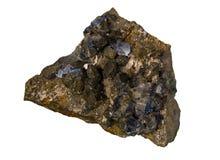 Naturliga morionkristaller på ett stycke av vaggar isolerat på vit bakgrund royaltyfria foton