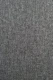 Naturliga texturerade mörka grå färger för vertikal grunge svärtar säckvävsäckvävhessians, den gråa dekoren för stoppningsäcktext Arkivbilder