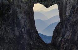 Naturligt hål som ser som en hjärtaform Royaltyfri Bild