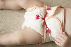 Naturligt tyg som är återvinningsbart, bomull behandla som ett barn blöjan, närbild Royaltyfri Bild