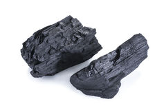 Naturligt wood kol som isoleras på vit, traditionellt kol royaltyfri fotografi