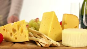 Naturmort Wine Cheese And Vegetables On The Table stock footage