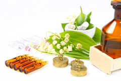 Naturopathy, digitalis. In ampoules and lily of the valley royalty free stock image