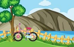 Naturplats med cykelparkering vid sjön stock illustrationer