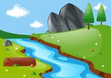 Naturszene mit Fluss und Feld Stockbilder