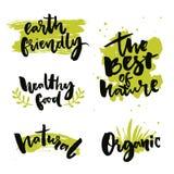 Natuurlijk productkentekens en etiketten Stickers met kalligrafiewoorden Het beste van aard, gezond voedsel, vriendschappelijke a royalty-vrije illustratie