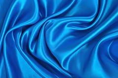 Natuurlijke blauwe de textuurachtergrond van de satijnstof Royalty-vrije Stock Foto