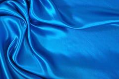 Natuurlijke blauwe de textuurachtergrond van de satijnstof Stock Afbeelding
