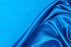 Natuurlijke blauwe de textuurachtergrond van de satijnstof Stock Foto