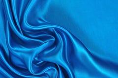 Natuurlijke blauwe de textuurachtergrond van de satijnstof Royalty-vrije Stock Afbeelding
