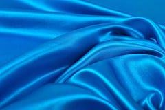 Natuurlijke blauwe de textuurachtergrond van de satijnstof Stock Fotografie