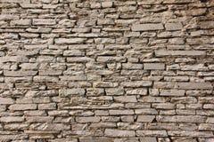 Natuurlijke de muurachtergrond en textuur van de grunge bruine steen Royalty-vrije Stock Foto's